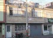 casa de 3 pisos con negocio en calle muy comerciante