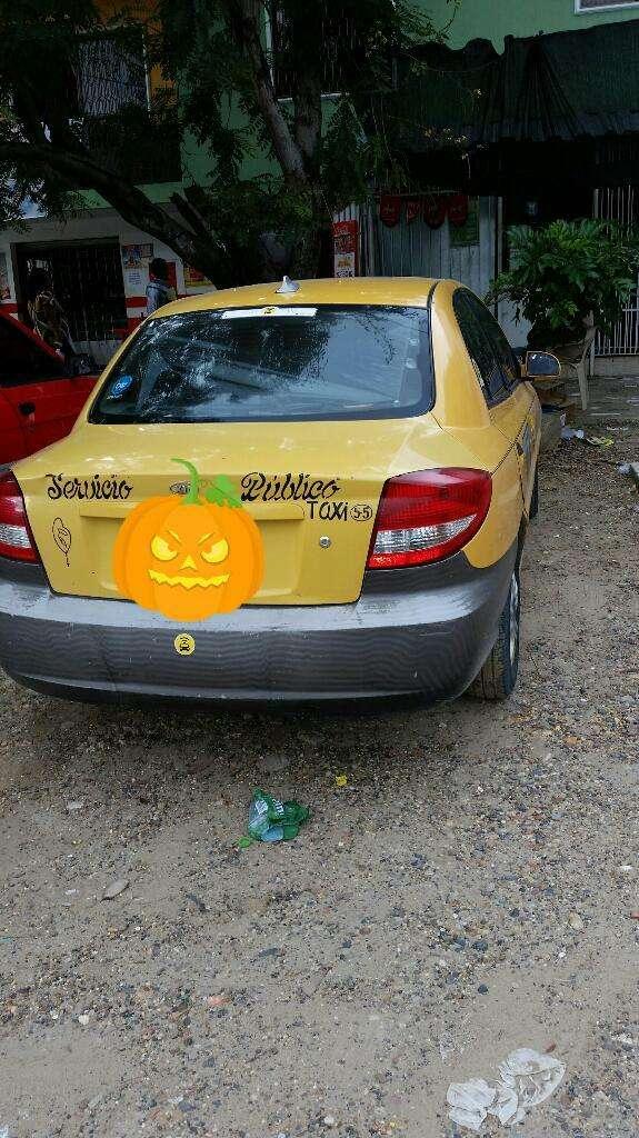 Excelente Taxi Kia 2008