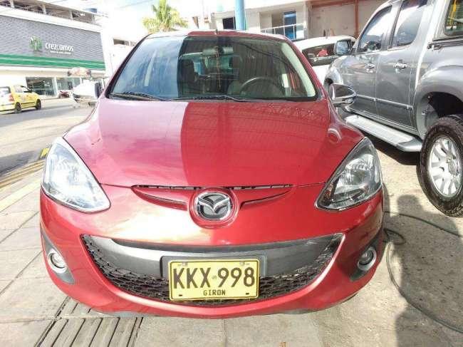 Excelente Mazda 2