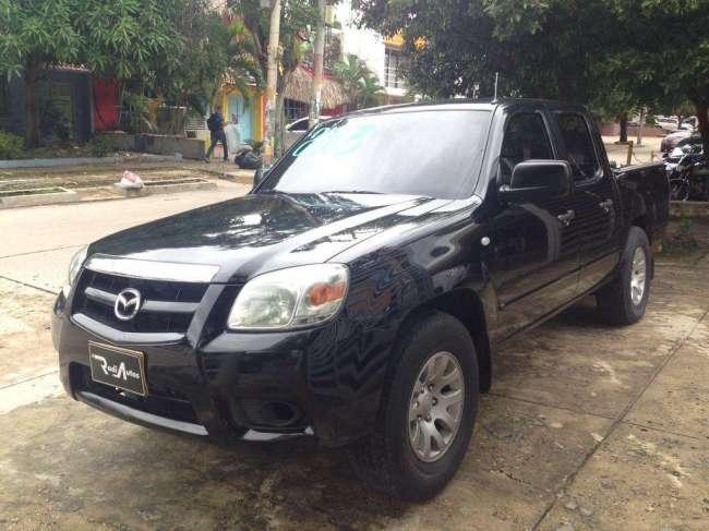 Excelente Mazda Bt 2013