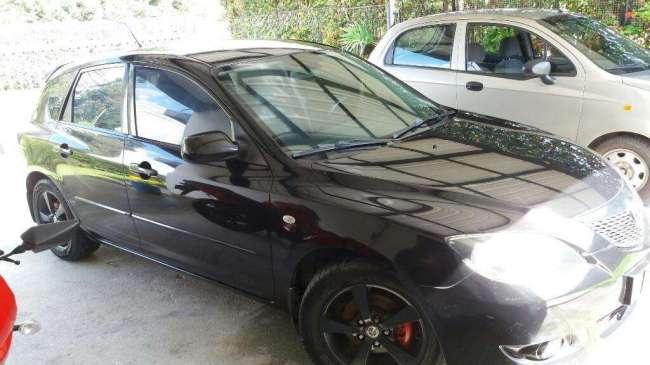 Excelente Mazda 3 Exelente