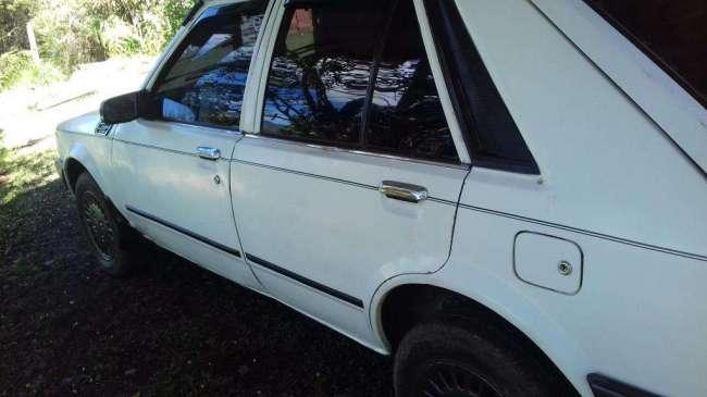 Mazda 323 4 puertas mod.87