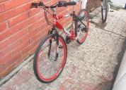vendo bicicleta tipo todo terreno  color roja y negra .perfecto estado marca tt lugan