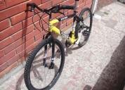 vendo bicicleta tipo todo terreno  color  amallilla y negro y la azul .  perfecto estado.