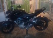 Vendo moto con papeles aldia color negro