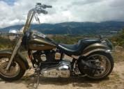 Harley davidson heritage hermosa personalizada todo al dia color dorado
