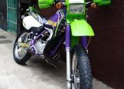 Se vende hermosa kmx 125 modelo 2002 color morado