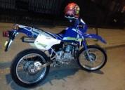 Vendo hermosa kmx 125 color azul