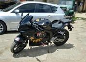 Se vende linda moto um 250 al dia color negro