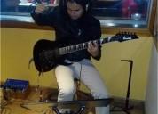 Clases de musica guitarra acustica y electrica bajo electrico teclado canto y bateria en bogotá