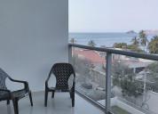 Lindo apartamento a media cuadra de la playa.
